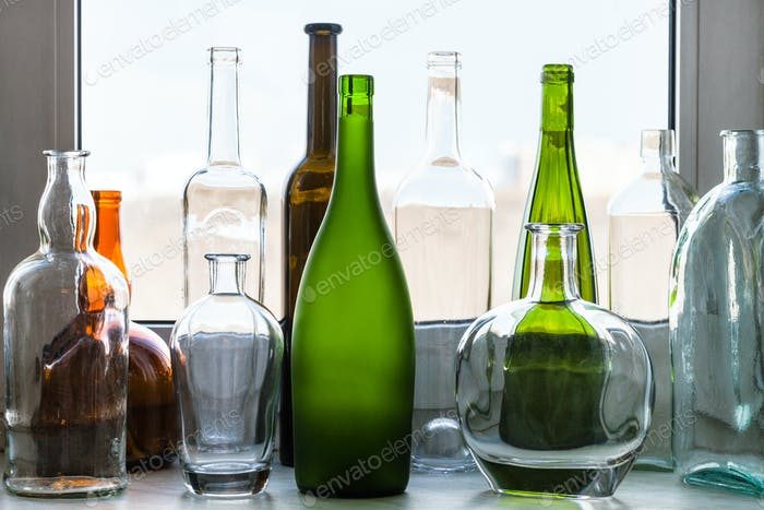 various empty bottles on windowsill at home