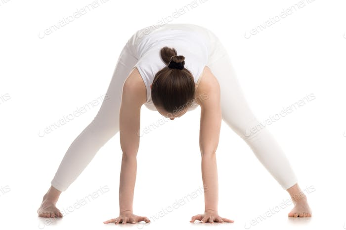 Yogi female doing Prasarita Padottanasana pose