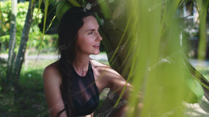 peaceful woman spending time at exotic seaside