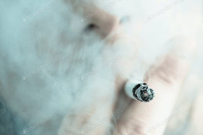 Man smoking out himself with a cigarette