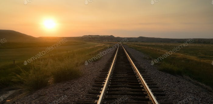 Railroad Tracks Reflect Sunrise Rural American Transportation
