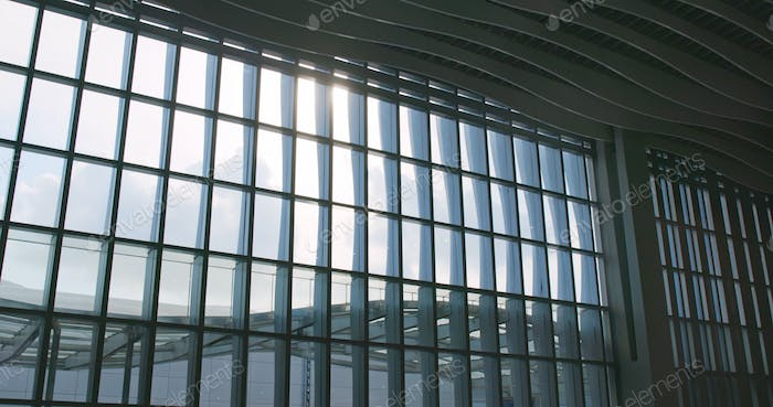 Airport window with sunlight flare