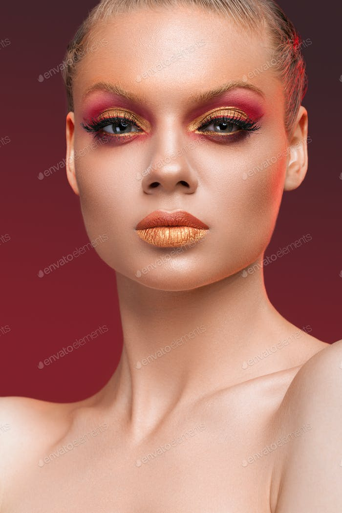 Beauty portrait of woman with red makeup