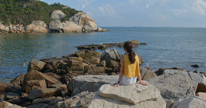 Woman enjoy the view of the sea