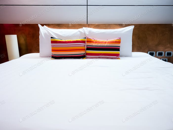 Clean and neat bed in concept of pleasure stay and good night
