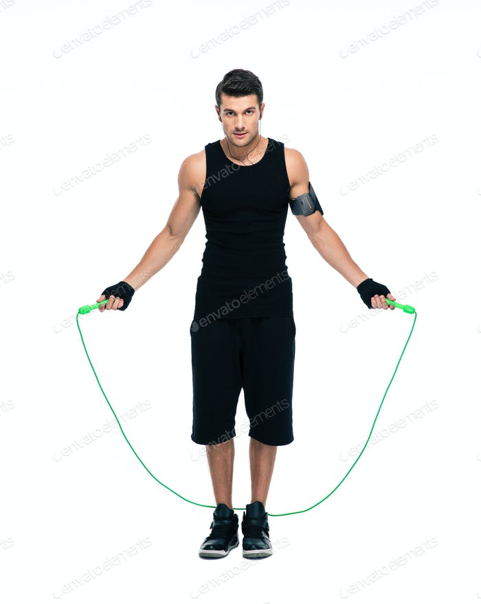 Handsome man working out with skipping rope