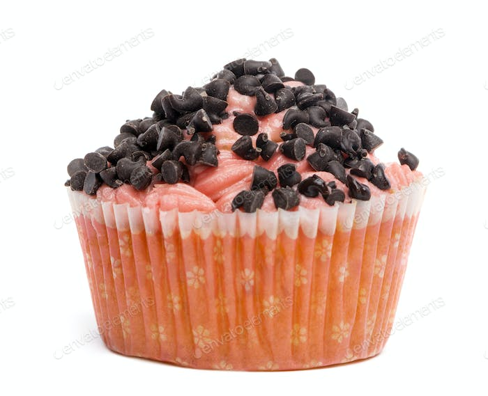 Cupcake covered with chocolate sprinkles against white background in front of white background