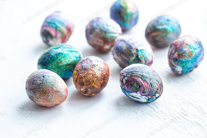 Cosmic coloring of Easter eggs on a light background.