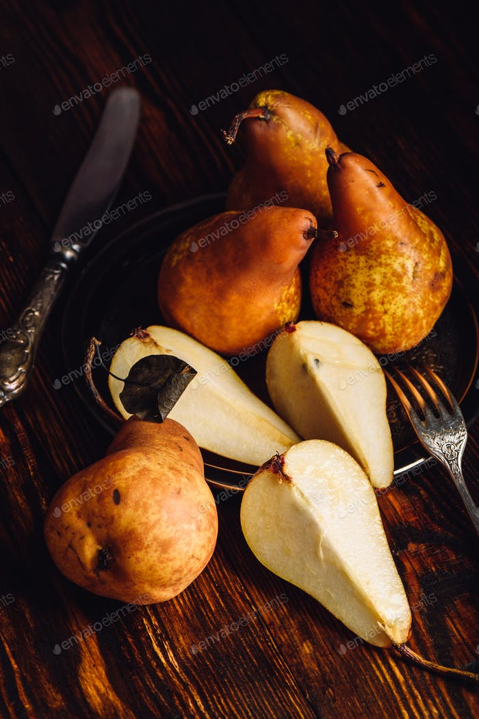 Few Golden Pears on Wooden Table.