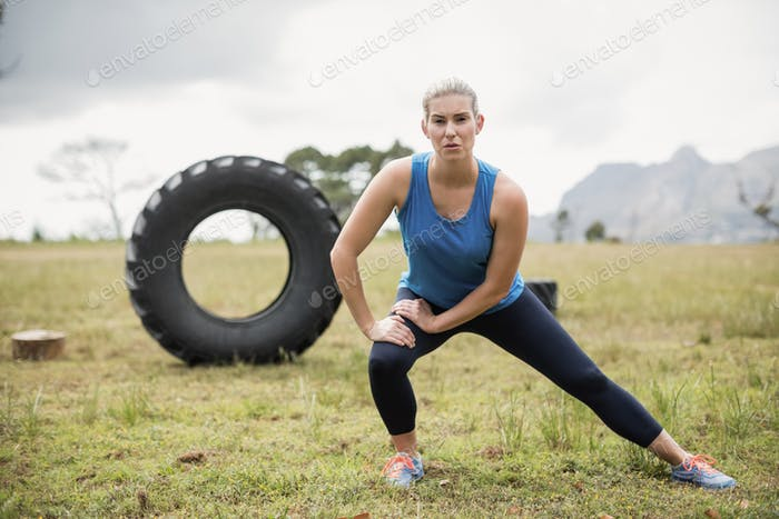 Fit woman performing stretching exercise