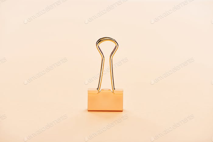 Paper Clip on Beige Background With Copy Space