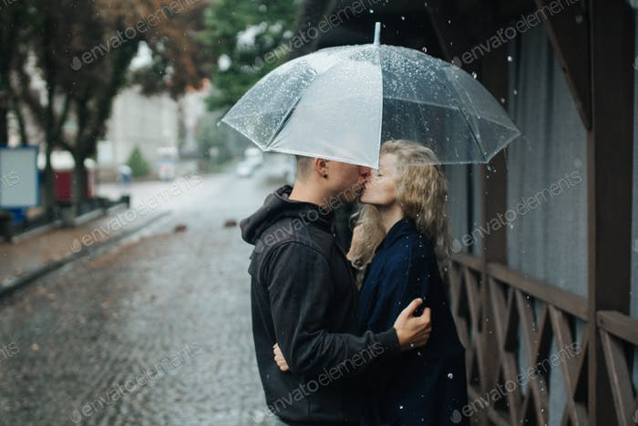 Couple on the street with umbrella