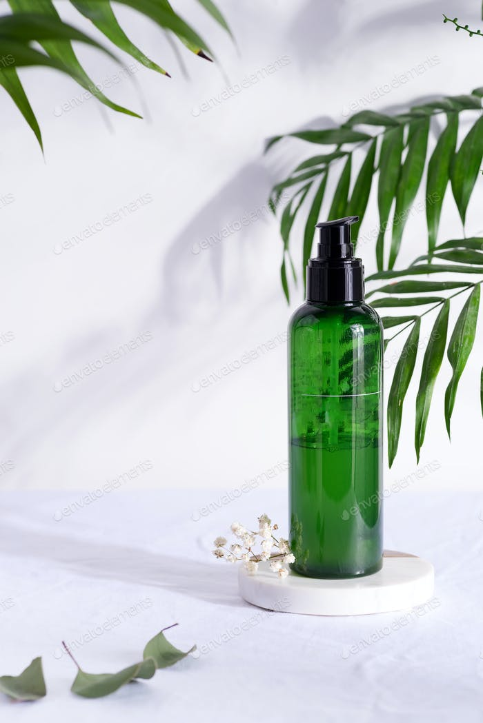 Cosmetic green bottle containers with tropical leaf shadow, branding mock-up, Natural beauty product