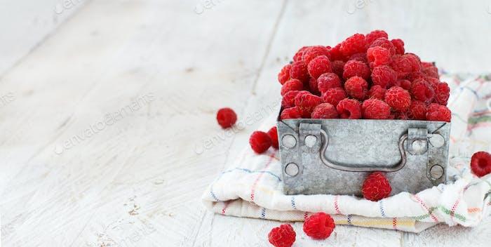 Fresh raspberries in a box