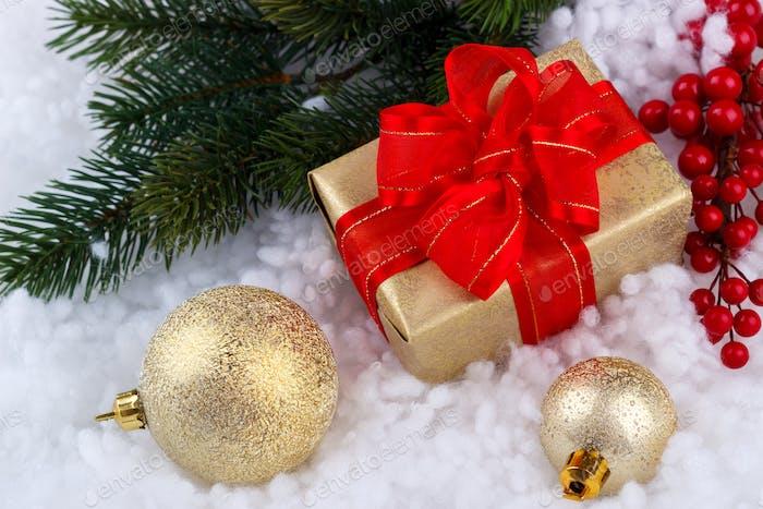 Christmas gift box on snow