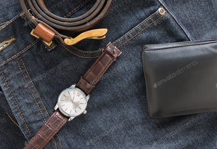 Wristwatch and wallet on denim jeans pocket-2