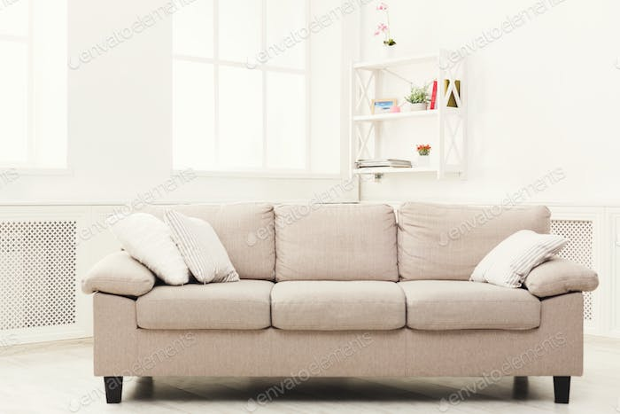 Beige couch on white window background