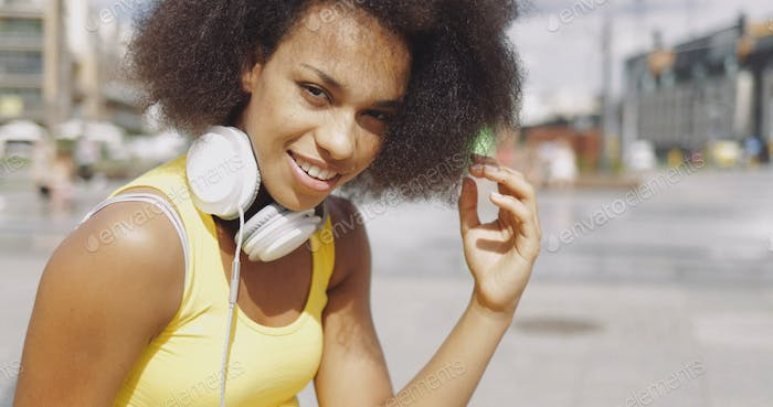 Model in headphones at street