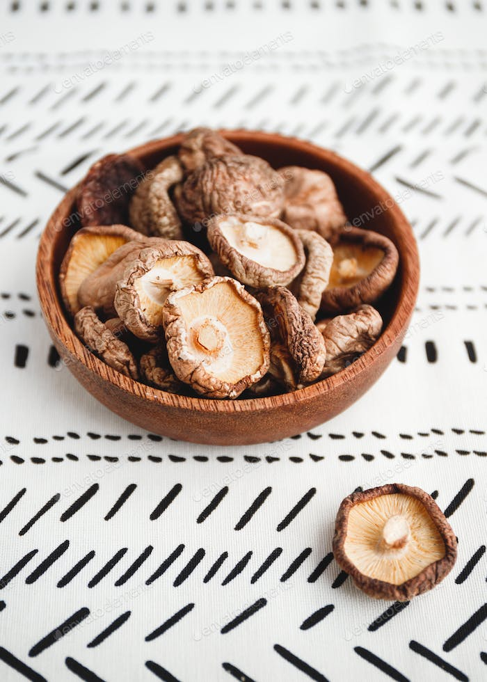 Chinese dried mushrooms Shiitake in a wooden bowl on a table