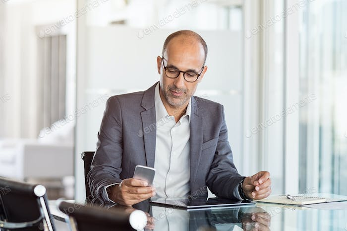 Businessman working on phone