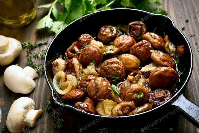 Fried mushrooms in frying pan