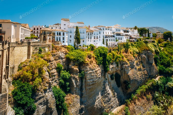 White Traditional Houses Over The Tajo De Ronda Is A Gorge Carve