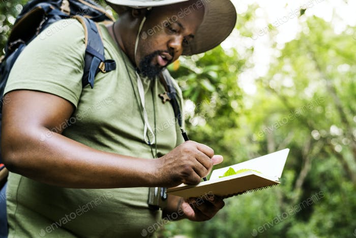 Botanist making notes in his notepad