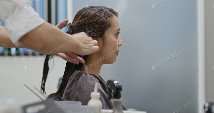 Asian woman with hair coloring in process