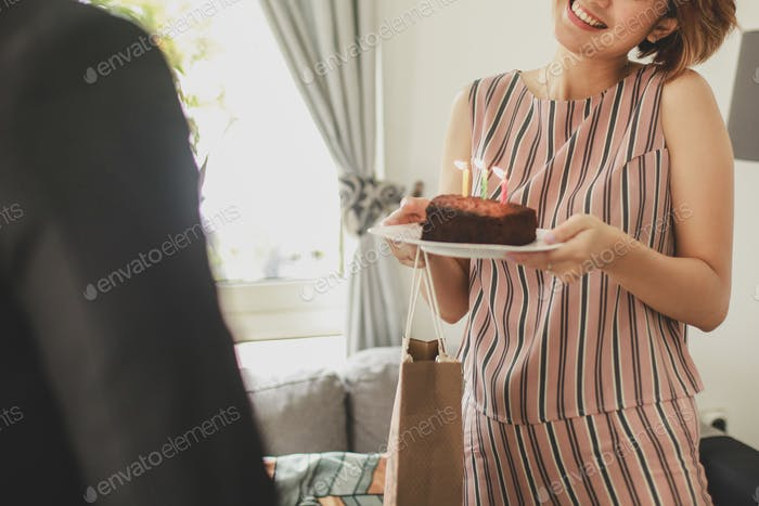 Woman giving birthday surprise