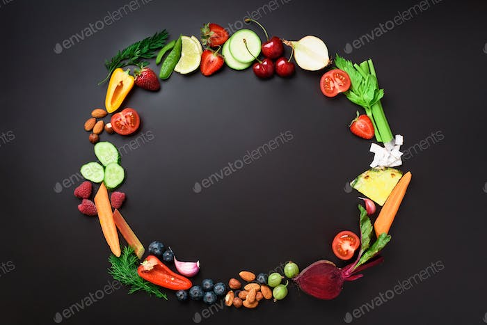 Healthy food background. Circle of organic vegetables, fruits, nuts, berries with copy space on