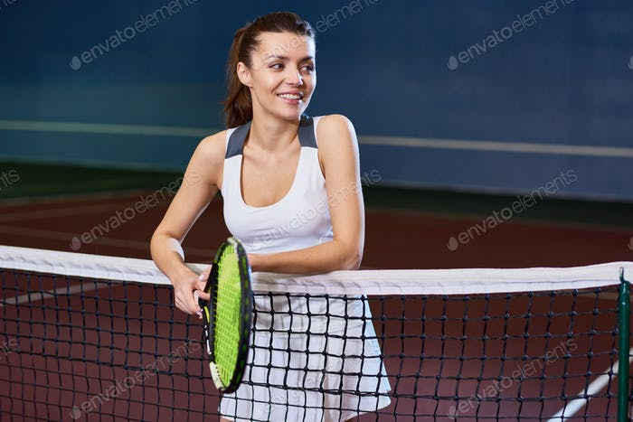 Female Tennis Player in Court