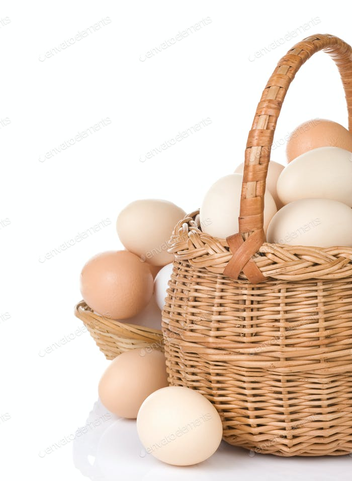 eggs and basket isolated on white
