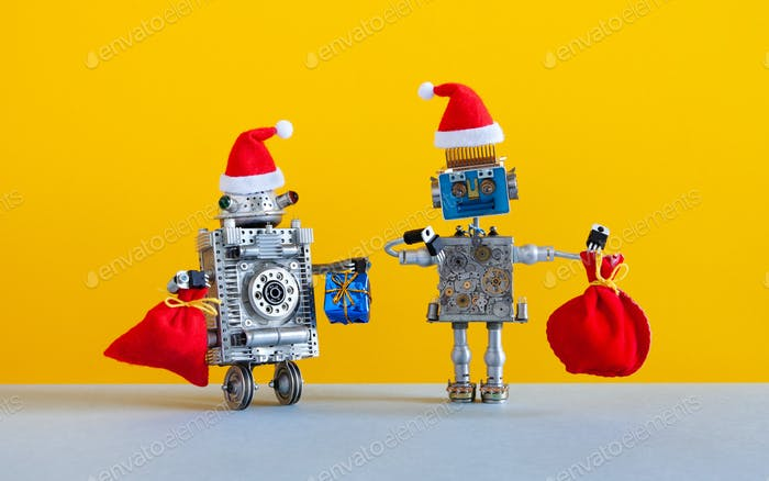 Two happy Santa Claus robots with a bags of Xmas gifts