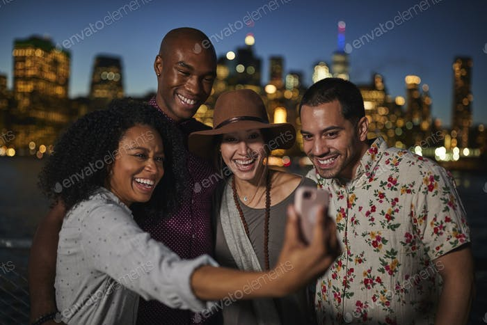 Group Of Friends Posing For Selfie In Front Of Manhattan Skyline