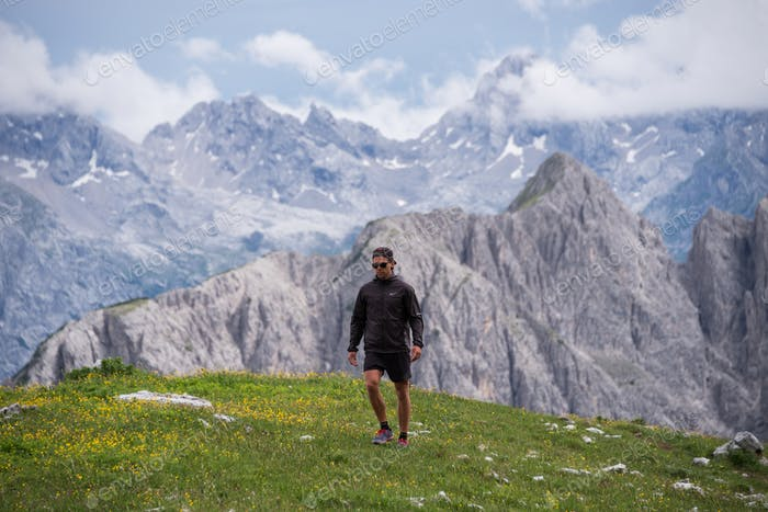 Hiker in the Dolomites mountains in Italy