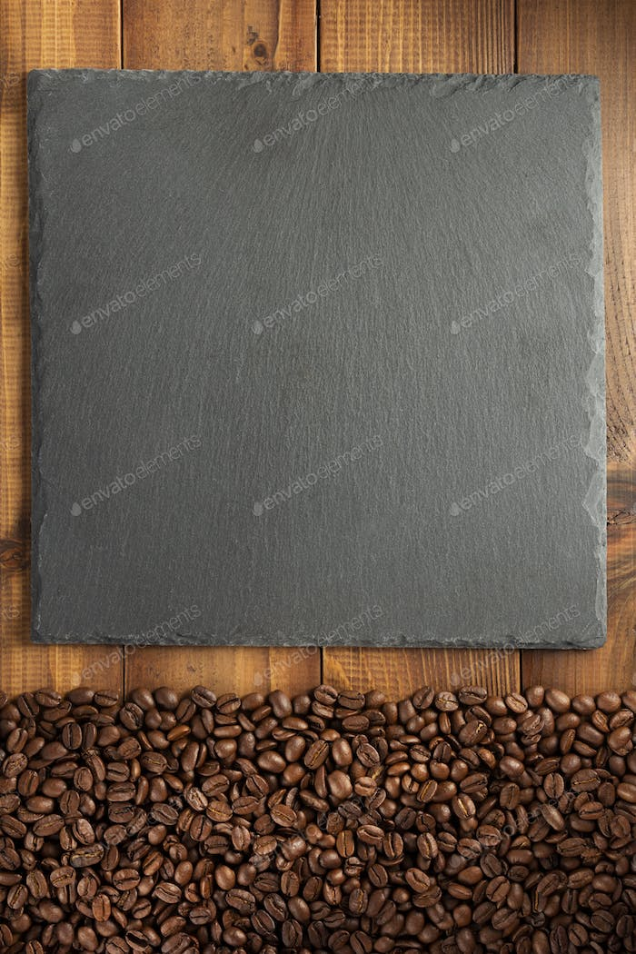 coffee concept beans and slate stone