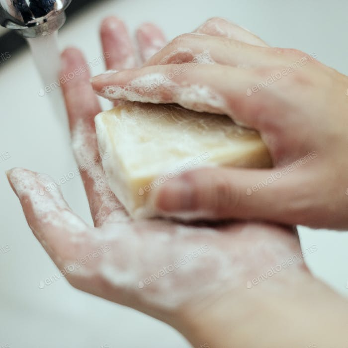 Washing hands with a bar soap to prevent coronavirus contamination