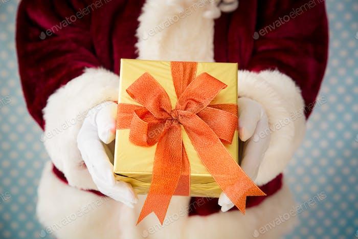 Santa Claus holding gift box