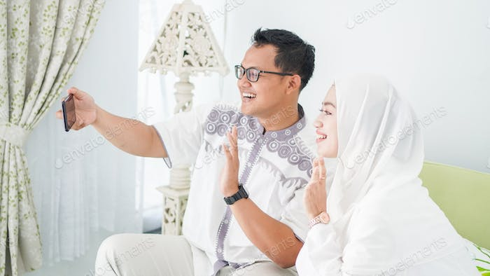 Asian Muslim families celebrate Eid together while on video calls