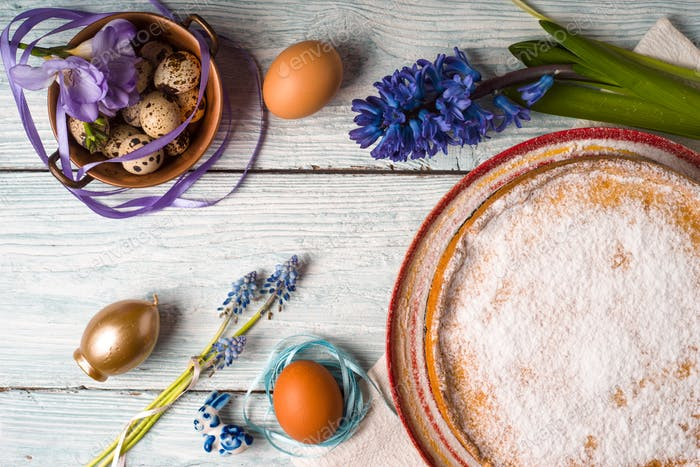 German Easter cake with decoration and flower on the white wooden table top view