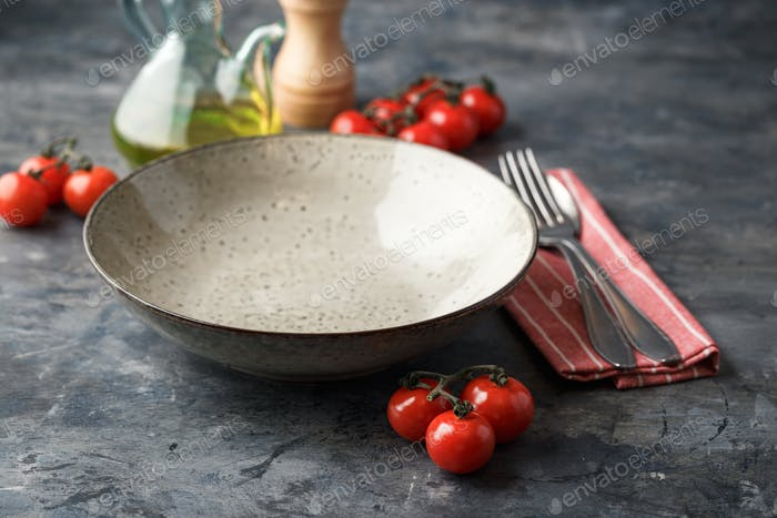 Table Setting With Cutlery, Tomatoes, Cheese and Eggs
