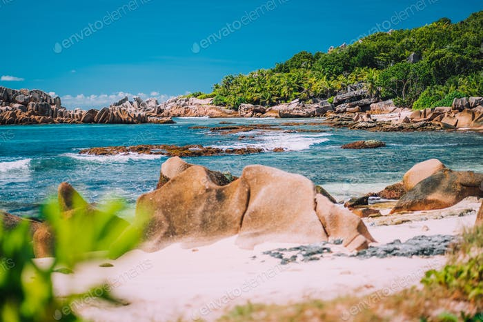 La Digue, Seychelles. Tropical exotic hidden paradise beach with granite boulders and coconut palm