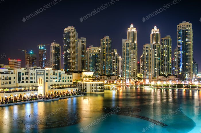 Downtown area during calm night with colorful neons. Dubai, United Arab Emirates.