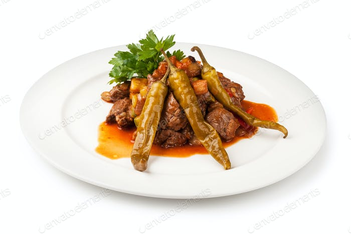 pieces of meat cooked with onion, tomato and pepper