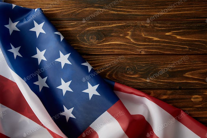 partial view of united states of america flag on wooden surface