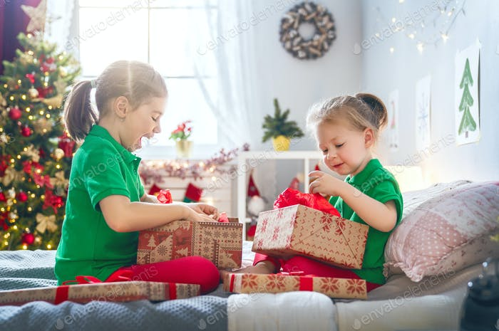 children opening Christmas presents