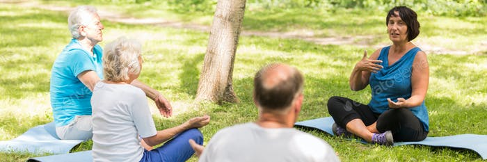 Senior people doing breathing exercises in the park