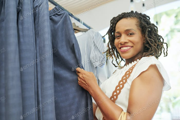 Woman choosing a suit in the shop