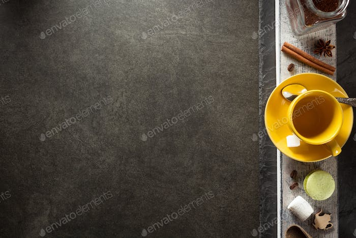 cup of coffee and ingredients on table