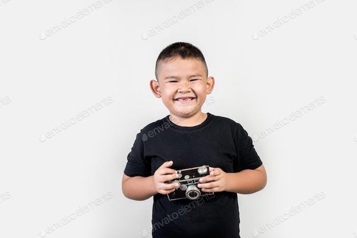 Kid photographer take a photo